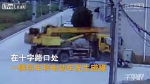 Crane truck crashes into a motorcyclist and a building