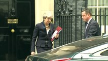 Theresa May departs 10 Downing Street ahead of PMQs