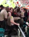 LADY GETS THROWN OUT OF GAME PUNCHES COP ON WAY OUT PAYBACK ENSUES