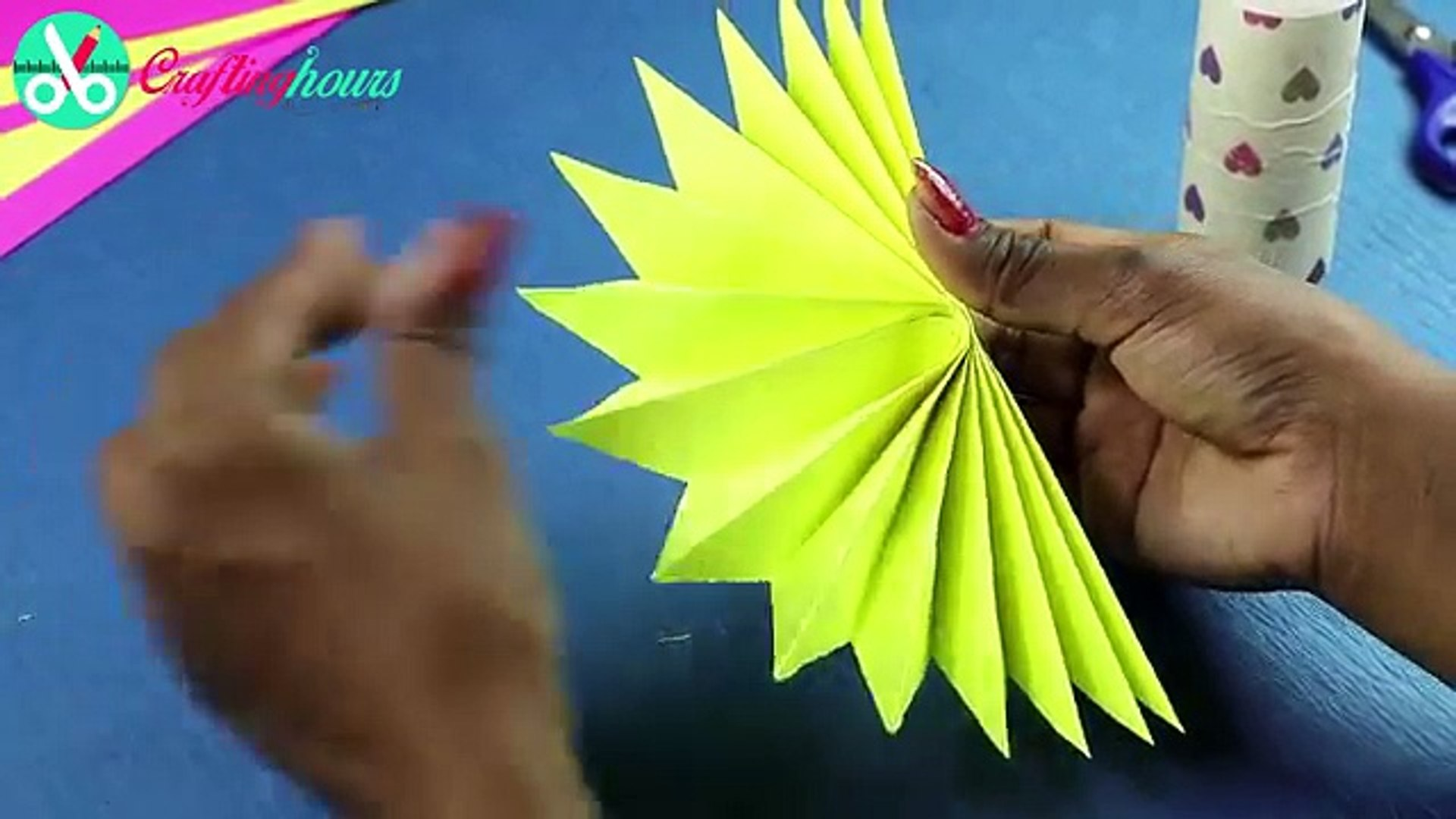 DIY Paper Rosettes Garland for Simple Party Decorations on Budget