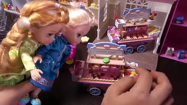 Elsa and Anna toddlers shopping for food at Barbies store and shopping list trick