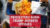 Protesters burn effigies of Donald Trump and Philippines president Rodrigo Duterte
