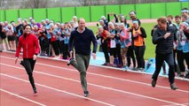 Kate Middleton, Prince William and Prince Harry as they take part in a relay race