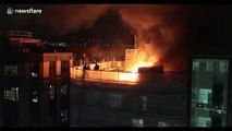 Firefighters tackle blaze on roof of London building