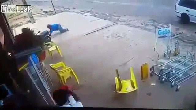 LiveLeak com - Angry Russian Storekeeper Chases Robbers from Store