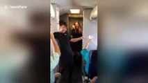 Flight attendants dance and sing during Southwest airlines flight