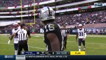 Oakland Raiders wide receiver Johnny Holton, New England Patriots cornerback Jonathan Jones get into it after play
