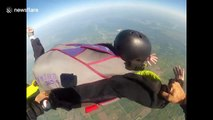 Skydiving student spins in the air like a top