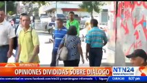 Ciudadanos venezolanos con opiniones divididas sobre el proceso de diálogo