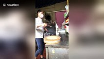 Young chef shows off meat cleaver spinning techniques
