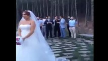 Newlywed bride throwing bouquet to...