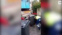 Sur le verglas cet éboueur galère à ramener les poubelles au camion !