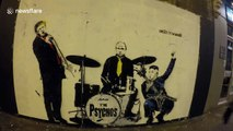 """Banksy-style street art depicts Donald Trump as lead singer of """"The Psychos"""""""