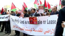 Palestinians mark Orthodox Christmas amid protests over land deals