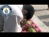 Most green coconuts smashed with the head in one minute - Guinness World Records