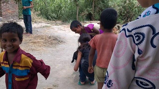 Bihari and Delhi's Children playing with lamb in Harpur Village