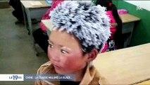 Un enfant chinois arrive avec les cheveux gelés en classe et déclenché un énorme élan de solidarité - Regardez