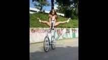 Cette jolie demoiselle enchaine les tricks impressionnant en vélo
