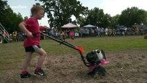 Competitors race motor-powered garden tillers in bizarre race