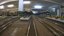 Train cab ride along a never ending model railroad layout in HO scale