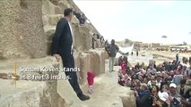 The world's tallest man and shortest woman visit the Pyramids of Giza in Egypt