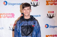 Louis Tomlinson discusses watching One Direction bandmates perform