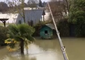 French Fisherman Casts Line From Balcony Into Seine Floodwaters