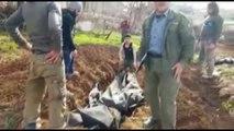 Afrin'de Pyd'lilerin Cesetleri Gömülüyor- Türk Silahlı Kuvvetleri'nin Zeytin Dalı Operasyonunda Etkisiz Hale Getirilen 900'e Yakın Pyd Terör Örgütü Üyesinin Cesetleri, Özgür Suriye Ordusu Tarafından Açılan Büyük Mezarlara Gömülüyor