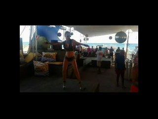 Go-Go Dancer In A Bar On A Beach