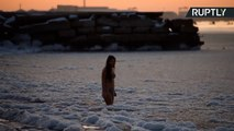 She-Daredevil Swims In Frozen Caspian Sea at Dusk in Just Her Swimsuit