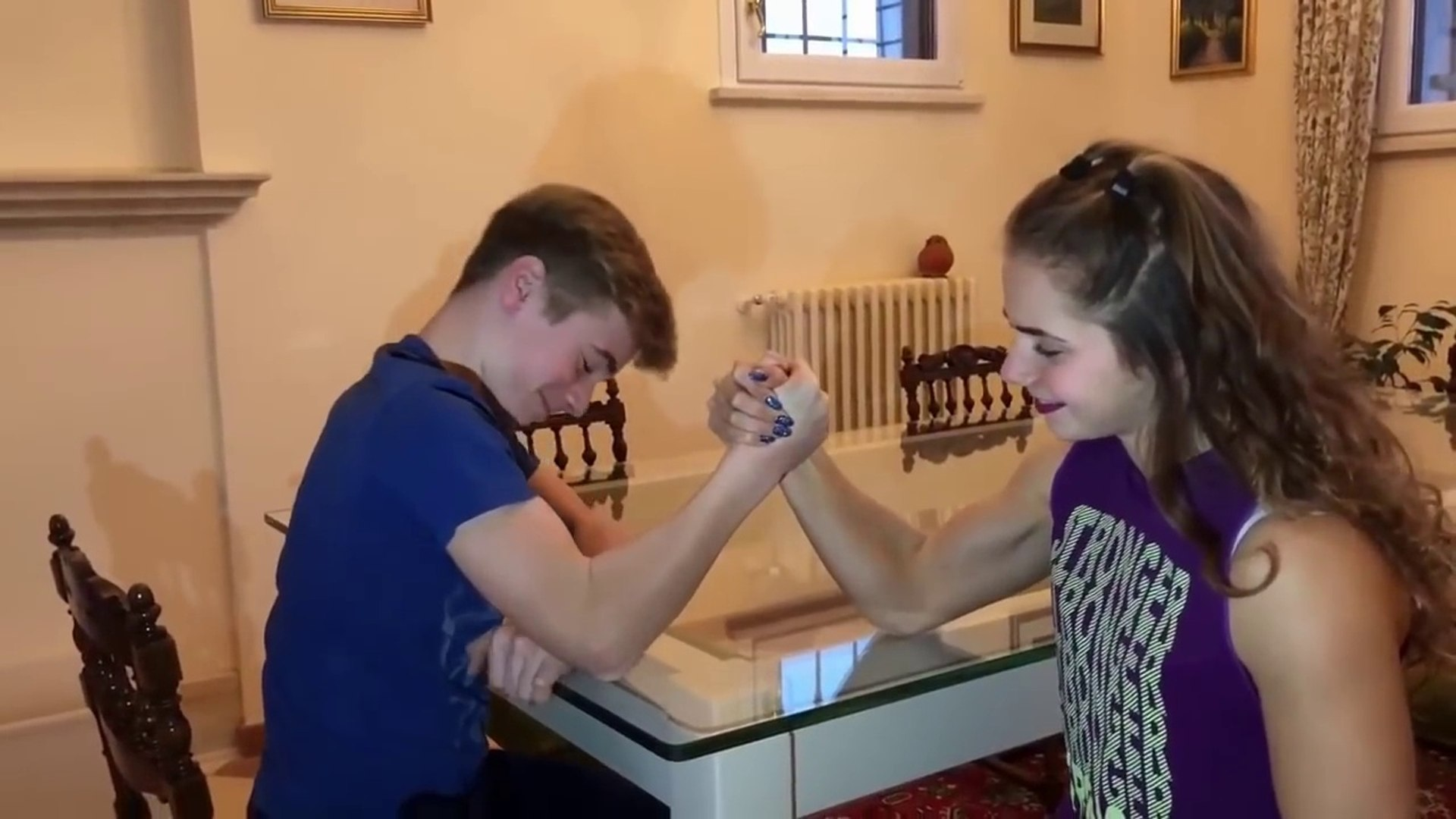 Teen muscle girl Emily Gervasio flexing biceps and mixed Armwrestling