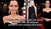 Angelina Jolie, Margot Robbie and Jennifer Lawrence exude old Hollywood glamour in show-stopping black gowns as they lead Britain's first major Time's Up protest on the BAFTA red carpet.