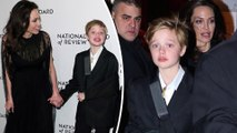 Pictured: Shiloh Jolie-Pitt shows off cast in black sling after breaking arm as well as new braces as she joins mom Angelina Jolie at awards show.