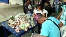 Venezuelan Craftsman Makes Handbags Out of Worthless Banknotes