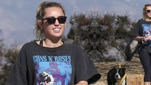 Miley Cyrus is rock star chic as she wears Guns N' Roses tee during hike with pet pooch Mary Jane in Los Angeles.