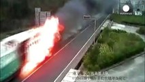 Driver steers flaming truck through tunnel, China