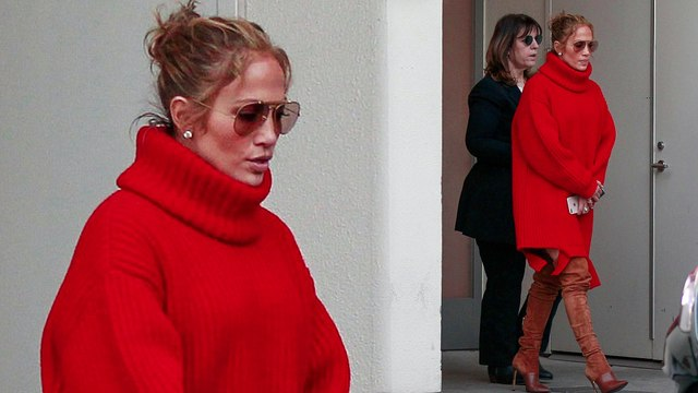 Jennifer Lopez wraps up in over-sized scarlet sweater dress and thigh-high boots for designer shopping spree.