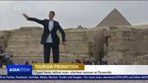 Egypt hosts tallest man and shortest woman at Pyramids to promote tourism