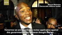 Fists fly in South African parliament as members of an opposition party forcibly ejected