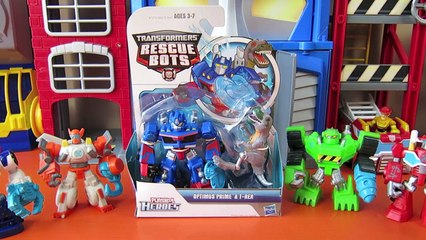 TRANSFORMERS RESCUE BOTS OPTIMUS PRIME TAKES ON T-REX WITH HEATWAVE CHASE BOULDER BLADES