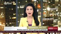 Tens of thousands of Indonesian Muslims march to Jakarta protest against capital's governor