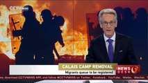 Calais camp clearance: Migrants queue to be registered