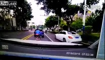 Man on a scooter brake checks a car and drives off. Driver chases and crashes into him