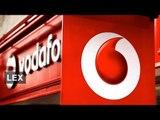 Vodafone invests for upturn