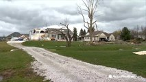 Trees down, buildings destroyed as strong winds whip across the US