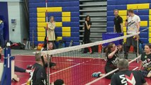 Prince Harry throws a ball at volleyball trials