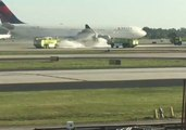 Atlanta Airport Firefighters Spray Foam on Delta Plane's Smoking Engine