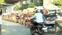 Rickshaw puller drags along 25 rickshaws - only in India!