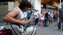 Street performer shreds his guitar at the speed of light