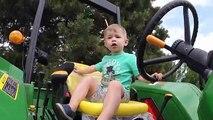 Cute Boy Drives John Deere Tror. Trors for Kids. Video for Children. John Deere Toys